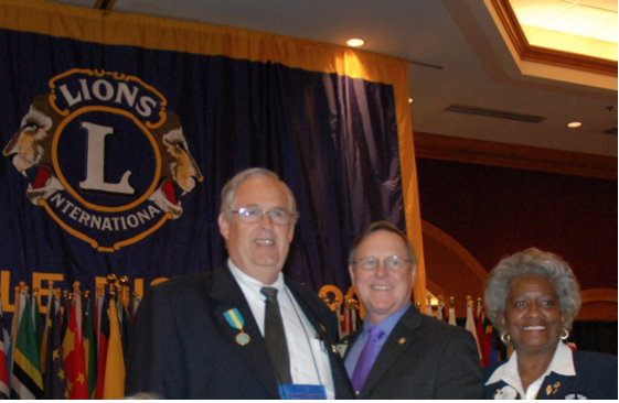 Lion Charles McBride with LCI President Joe Preston and PCC Gloria Askew